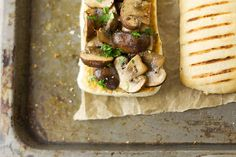 Garlic mushroom bruschetta on baking tray close up by Kirsty Begg