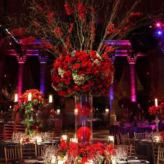 This is probably the most dramatic and extravagant wedding ceremony decor I've seen so far...I love the red roses and the tall centerpieces.  Darker receptions are so romantic!