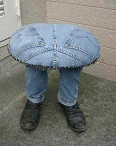 I can't believe this!!!!! This is extremely so hilarious!  Jeans table or footstool that has legs standing in boots.