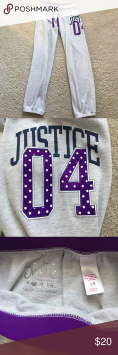 Gray and Purple Graphic Justice Sweatpants Size 18 Gray Justice sweatpants with purple accents. Has a logo on side of leg, shown in pictures. Stretchy ankles and elastic waistband with drawstring. Size 18 Justice Bottoms Sweatpants & Joggers