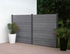 trex fencing or metal fence panel and posts wood fence panels bamboo fencing panels Fence Panels And Posts, Metal Fence Panels, Privacy Fence Panels, Metal Screen, Patio Privacy, Fence Posts, Diy Garden Fence, Backyard Fences, Patio Fence