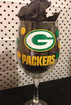 To add to my wine glass collection!  Green Bay Packers Football Wine Glass on Etsy, $15.00