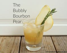 The Bubbly Bourbon Pear: an easy fall cocktail recipe garnished with sugared rosemary, perfect for Thanksgiving or your autumn party!