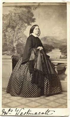 Photo by Symons Of London Eng. Lady Id as what looks io me like  I W Westmacott,your welcome to have a guss at it your self. but that is some pretty polka dot dress and mantle