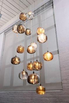 I am in ♥ with these hanging lights from Viso Inc! Love the colors, but would love to have different colors for different rooms.