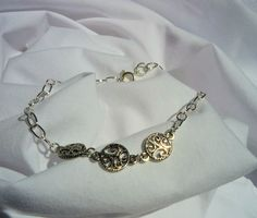 Elegant Bracelet of three tree design. Saving one tree at a time...