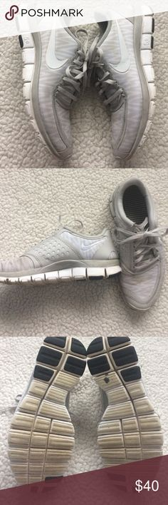 Nike Free 5.0 Grey + White Good used condition, several faint marks on top, sides from being worn, may be removable. Normal signs of wear but lots of life! Nike Shoes Athletic Shoes