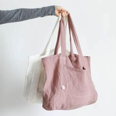 Linen inspires us to enjoy slow living. Ourbreathable and lightweight tote bag has a gauzy crinkle texture.Perfect tote to use as market bags, storing knitting projects, or chunky blankets.  100% crinkle linen Exterior pocket 2 handles Size: 15.5 x 13.5 x 5 inches Machine wash gentle Gentle dry.  Crinkle linen bag Big Tote Bags, Canvas Tote Bags, Shopping Tote Bags, Tote Bags For School, Canvas Totes, Sacs Design, Linen Bag, Fabric Bags, Market Bag