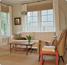 white curtains and bamboo shades - light floors, light walls, light shades
