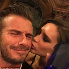Pucker up! Victoria Beckham gave her husband David a smooch on the cheek as she attended h...
