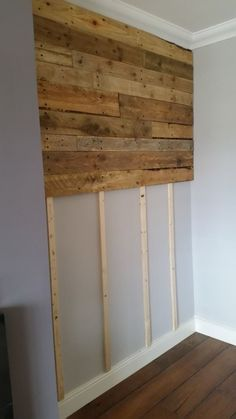 Pallet wall. Breaking apart pallets is hard work but this could be a great idea for the fireplace .