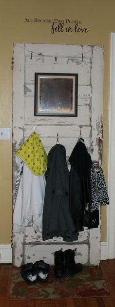 Old Door turned into coat rack :) Added mirror, old hooks and old keys hanging from twine.