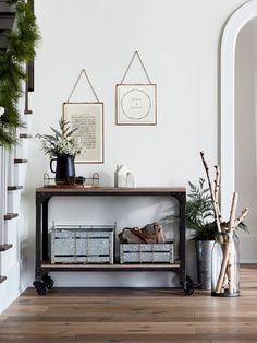 I love this whole set up with the rustic decor and my favorite, the hanging frames. I really want to get some of those...I don't have enough wall decor. I need to update my entryway. #affiliate