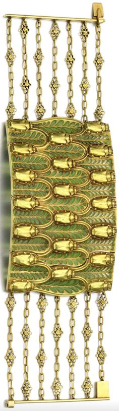An Art Nouveau gold and enamel jewel, René Lalqiue, early 20th century composite. The central articulated panel designed as a series of scarab beetle and foliate motifs set with plique-à-jour enamel, signed Lalique, to a series of fancy links of floral design. The bracelet was given as a gift from René Lalique to his daughter Suzanne Lalique, who then gave it as a wedding gift to the current owner's mother. #ArtNouveau #Lalique #bracelet
