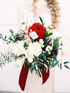 How beautiful is this red, green, and white bouquet for Rachel and Gabe's holiday wedding?! Photographed by Stephanie Hunter Photography. #bridesofaustin #wedding #bouquet