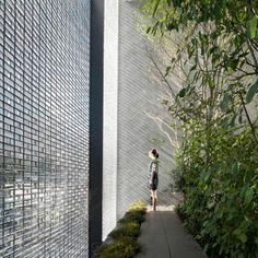 Eye Candy:    We're mesmerized by this house with a facade of shimmering glass bricks by architects Hiroshi Nakamura in Hiroshima, Japan.    Known as the 'Optical Glass House', it was constructed beside a busy road, so Hiroshi Nakamura and his studio NAP wanted to create a private oasis where residents could still make out the movements of people and traffic beyond the walls. 6,000 specially made glass blocks used to build a two-storey-high wall.     Eye Candy brought to you by…