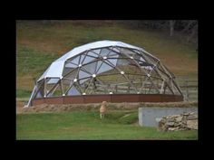 Growing spaces geodesic grow dome greenhouse being built stop motion.  The horses in the field on the first day...lol