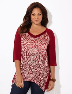 Integrity Top   Catherines Embrace the graceful ease of our stylish, scroll-print top. The intricate print decorates the front as a pointed, asymmetrical hem adds excitement to the hem. Stud embellishments scatter throughout for a metallic finish. V-neckline. Three-quarter sleeves. Side slits at hem. Solid back. Catherines tops are perfectly proportioned for the plus size woman. #catherines #fallfashion #plussizefashion