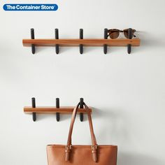 If there's an art to organization, this wall-mounted hook rack makes it simple. Its mix of natural wood with molded hooks creates the look of wall decor. Yet this rack is built for functionality. Organize an entryway with space enough for caps, keys, leashes and umbrellas. Maximize closet storage or display accessories for fast access. In a guest bath, a kid's room - wherever needed, this wooden rack helps keep everything neat, easy to grab and easy to put back where it belongs. Wooden Rack, Entryway Organization, Hook Rack, Container Store, Shopping Day, Wood Bridge, Closet Storage, Guest Bath, Natural Wood