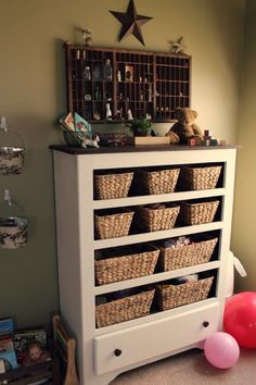 repurposing a thrifted chest of drawers...maybe something that is missing a couple of knobs. This one was only $9.50 at a local thrift store - add baskets for cute toy storage or craft supplies.