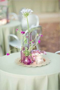 Instead of using one vase as a centerpiece, why not use several smaller ones in a variety of different shapes?