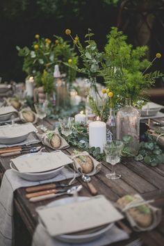 Beautiful outdoor table setting, love the foliage and candles.
