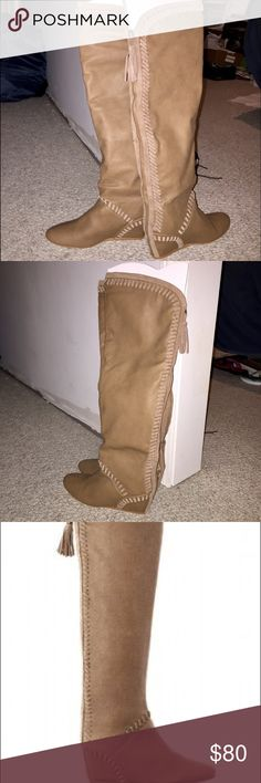 "Victoria's Secret Colin Stuart boots size 6.5 NEW! Victoria's Secret $178 Coffee Tan Whipstitch Wedge Tall Beige Boot 6.5  Colin Stuart private Label by Victoria's Secret has ""X"" on bottom of sole to prevent returns to the catalog or stores.   Victoria's Secret Whipstitch Wedge Boot.  Rear 1/4 Zipper. Soft Man Made Leather.  Depending on your leg length this might go over the knee. Condition: New  Size: 6.5 Color: Coffee Tan Fabric content: Man Made Approximate: Heel: 3"".  Length from top of…"