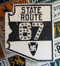 Two original Arizona state route signs. These ran from the late 1920s until around 1940. SR 67, is the only road that links historic Route 89a with the rim of the Grand Canyon. The Arizona DOT doesn't own the last miles of this route, but it is still labeled as SR 67. SR 61 runs through Apache County starting in Show Low, Arizona all the way to the New Mexico border.