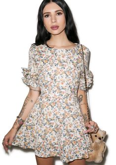 Wild Child Floral Dress yer gonna leave bitches pushin' up daisies when they see you in this dress. This stylish n' seductive fully-lined dress features an all-over silky floral print so sweet ya wanna pick em all. This exXxclusive dress is handmade and deliberately designed to fit most body types, from the ruffled sleeves, pleated a-line skirt, and rear invisible zip closure. It's an impeccable piece for the girl who just wants her house party on the prairie.