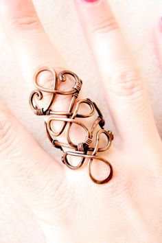 Wire wrapped adjustable copper ring.    Measuring 5.5 cm in height    Every jewel are handmade and unique,  all items will come packed in a