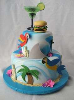 This Jimmy Buffett inspired cake is perfect for all you parrotheads. Repin if this is just the kind of cake you'd celebrate with.   #Margaritaville #JimmyBuffett #PartyIdeas