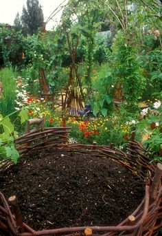 Rustic garden compost bin, that compost looks like it would make very happy plants!