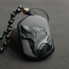 BLACK OBSIDIAN OKAMI - GrowndZero Harness the Spirit of the Great Wolf! Made of real, premium Obsidian One-of-a-kind, custom design. The Wolf is a creature with a high sense of loyalty and strength and Black Obsidian stone is a powerful cleanser. Wolf Jewelry, Stone Jewelry, Pendant Jewelry, Tribal Jewelry, Men's Jewelry, Pendant Necklace, Tassel Necklace, Gold Jewellery, Wolf Necklace
