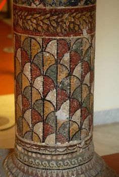 Pillar with elaborated mosaic from Pompeii. [Column as representation of the Firmament with circular wreath and scale pattern often seen on Osiris]