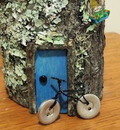 Adorbs fairy house, with especially adorable button-and-wire bike! This, that and everything inbetween
