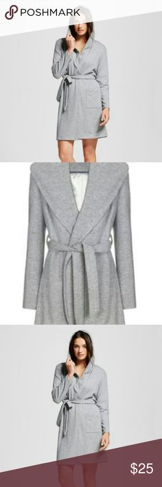 NWOT Beautiful grey old navy rob/sweater dress NWOT Beautiful designer brand old navy grey rob size xsmall women's ,brand new, never worn, super soft and comfortable! Has two pockets on sides with wrap around ties on outside of rob/sweater dress and inside. 100?polyester fabric and has fur on inside of sweater /rob.NWOT, super cute!Selling this beautiful designer brand for a great price!New! old navy  Intimates & Sleepwear Robes