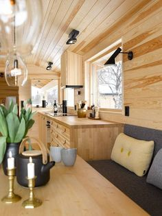 This fully wood-paneled Nordic style kitchen with glass pendant lights has a modern cabin feel to it. Wood Interiors, Cottage Interiors, Cabin Design, House Design, Small Living, Living Spaces, Scandinavian Cabin, Plywood Interior, Brown House