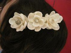 Wonderful hair barrett embellished with seashell flowers.  Great for beach theme wedding accessories.