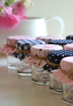 DIY favors: mini jars filled toped with fabric of your choice(maybe in your wedding colors) and tied with twine. Fill the jars with jam/hot coco powder/candy etc. the skies the limit! Wedding Favours, Diy Wedding, Wedding Gifts, Diy Candle Party Favors, Jam Favors, Party Favours, Pretty Designs, Partys, Jar Gifts