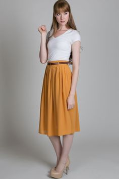 easy to style mid-length skirt. I love the color.