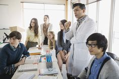 High school students and teacher in science class -