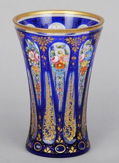 A Bohemian enamel and gilt decorated clear and blue flashed glass vase #glass #bohemian