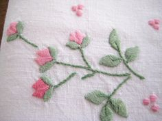 2 Vintage Fingertip Towels in White linen or cotton. These are embroidered with sprays of pink flowers and green leaves. In Excellent Vintage condition with no holes, tears, stains or marks. The last photo displays the towel embroidery work on both the front and the back - the towel on the right is the back of the cloth and the towel on the left shows the front. COLORS: White, 2 shades of pink, 2 shades of green.  MEASUREMENTS: Approximate - 16.5 x 11 3/4    **To view more vintage towels...