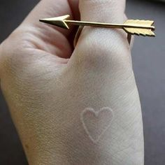 Small White Ink Heart Tattoo