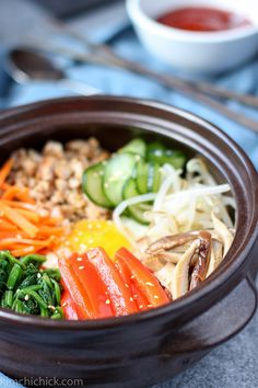 Bibimbap is a classic Korean dish with warm rice, sautéed vegetables, and eggs, all mixed together with a spicy Korean red chili sauce |www.kimchichick.com
