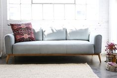 blue gray sofa from furniture maison with bohemian modern pillow / sfgirlbybay