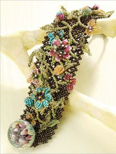 Spring Celebration by Cynthia Rutledge. Celebrate the coming of spring by making this delightful beaded flower bracelet!