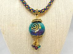 Teal and purple lampwork pendant on hand braided by thepinkmartini, $79.00