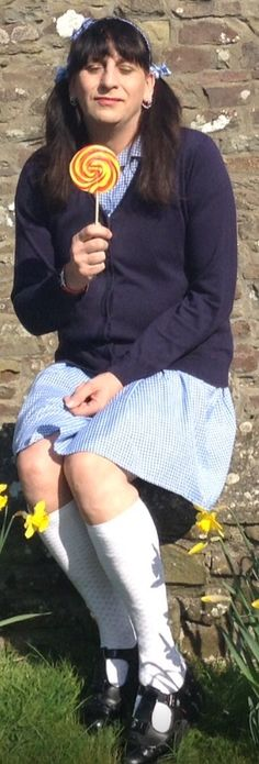 This is such a lovely pic of sissy Katie in her school uniform how cute does the Katie look here she makes a lovely schoolgirl dressed in her little girls t bar shoes and pelerine socks her gingham school dress and cardigan match so well and her hair in pigtails look lovely