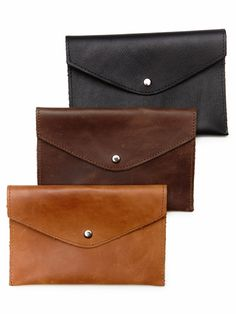 small leather goods giving back
